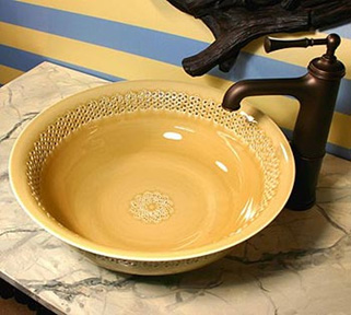 the Linkasink line of patterned bronze sinks