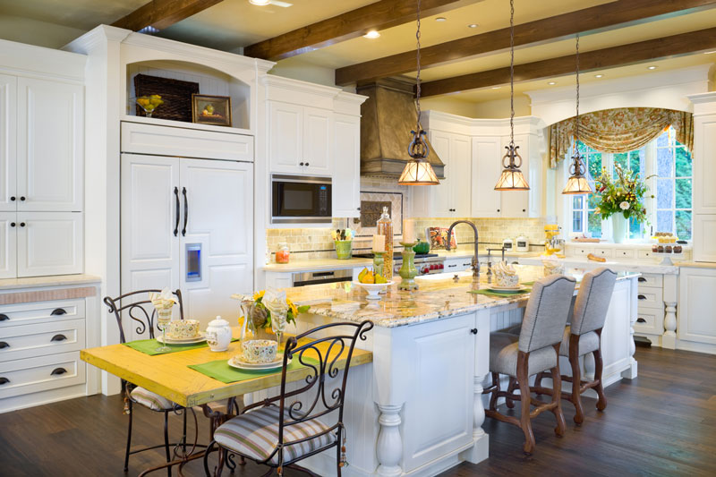 Great Kitchen Designs. White cabinets and rich wood floors add to the luxury appeal of this kitchen  design from House Plan 4912 which overlooks great room outdoor living Great Kitchen Designs for Holidays DFD Plans