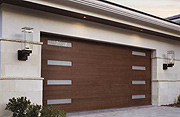 A Faux Wood, Low-Maintenance Garage Door with Modern Planks and Windows