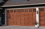 A Natural Wood Garage Door with Classic Short Panel Design with Divided Lite Windows